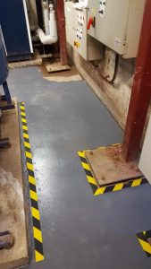 Painted floors in plant room with hazard tape at Dulwich College